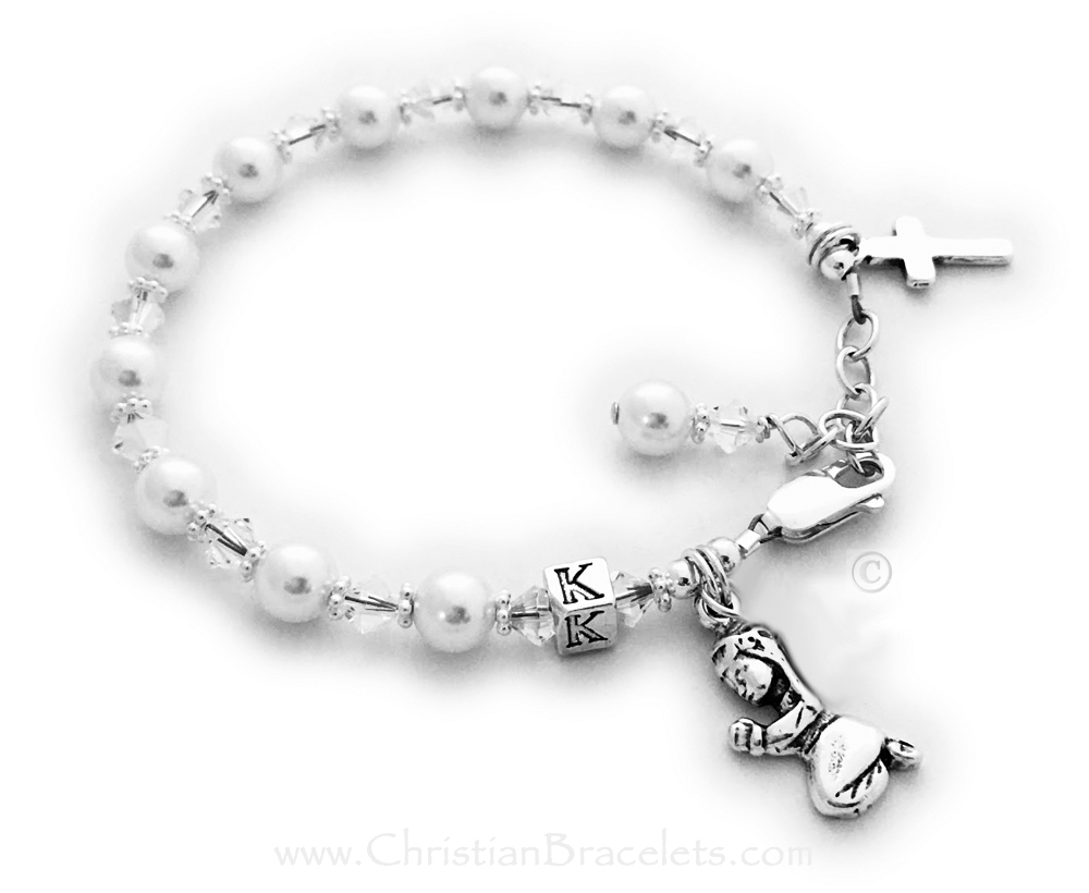 Confirmation Charm Bracelet (Shown with an add-on birthstone crystal dangle charm) Clear Swarovski Crystals and Pearls with a Praying Girl charm and Simple Cross charm come on this beautiful Confirmation Charm Bracelet. They picked the initial K during the ordering process and added a September Birthstone Crystal dangle. The sterling silver lobster clasp with an extenstion comes with this bracelet so it will grow with the little girl.