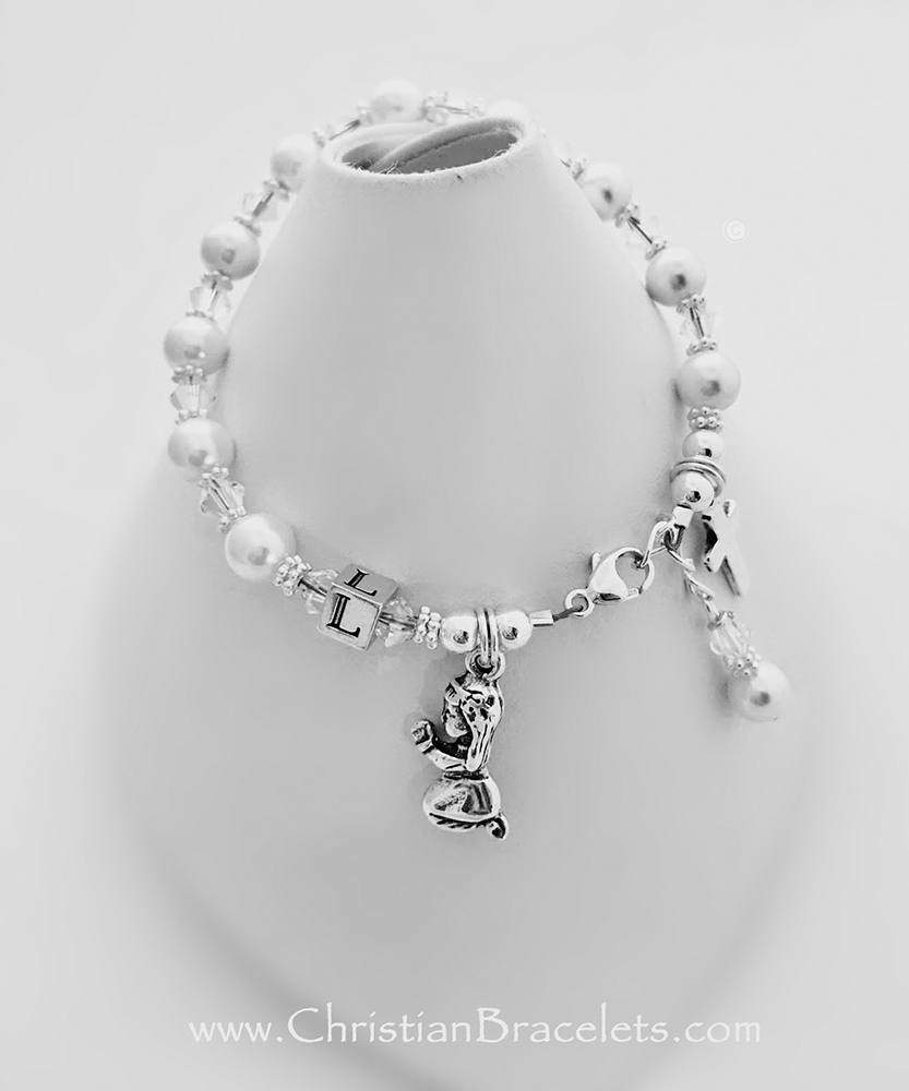 Confirmation Charm Bracelet Clear Swarovski Crystals and Pearls with a Praying Girl charm and Simple Cross charm come on this beautiful Confirmation Charm Bracelet. They picked the initial L during the ordering process. The sterling silver lobster clasp with an extension comes with this bracelet so it will grow with the little girl.