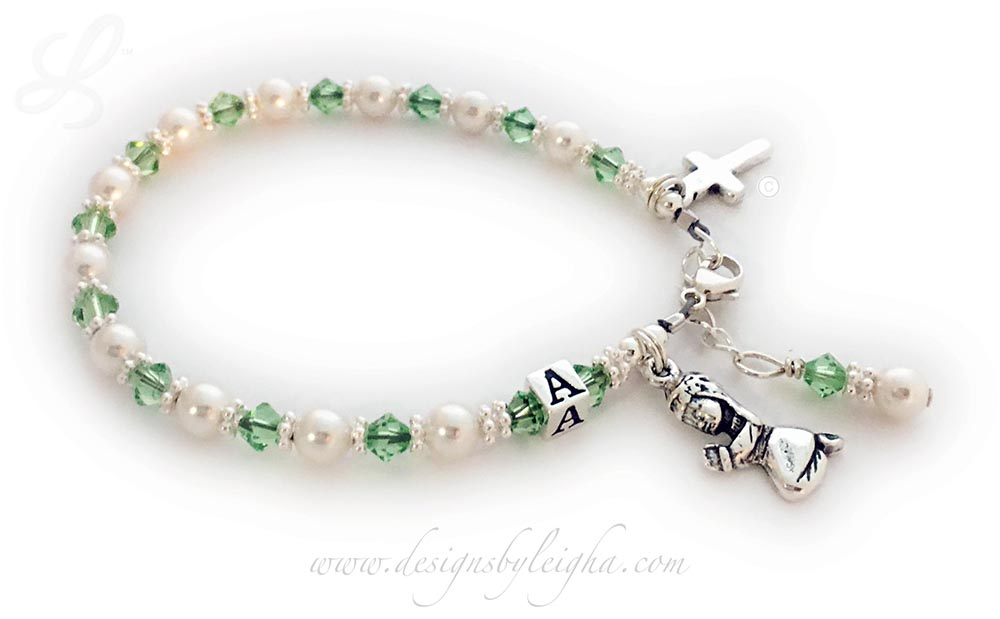 CB-Comm1 First Communion Bracelet™ or First Confession Bracelet™ August or Peridot Swarovski Crystals and Pearls with a Praying Girl charm and Simple Cross charm come on this beautiful First Communion Bracelet™ or First Confession Bracelet™ Bracelet. They picked the initial A during the ordering process. The sterling silver lobster clasp with an extension comes with this bracelet so it will grow with the little girl.