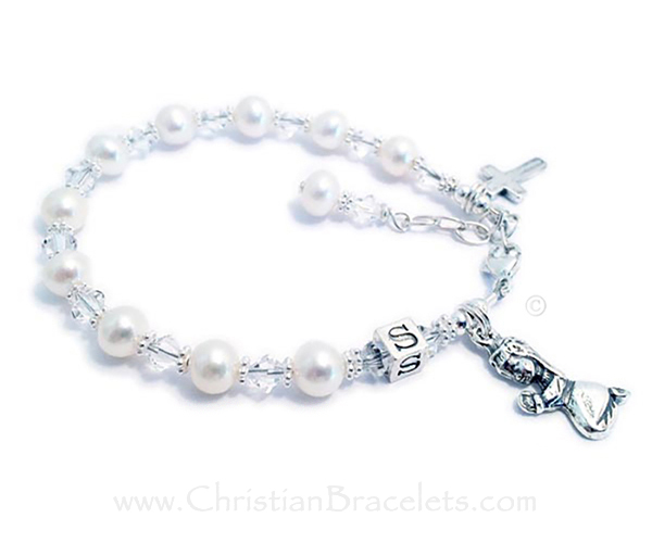 First Communion Bracelet Clear (April birthstone) Swarovski Crystals and Pearls with a Praying Girl and Simple Corss .925 Sterling Silver Charms are on this beautiful bracelet. They picked the initial S during the ordering process. The sterling silver lobster clasp with an extenstion comes with this bracelet so it will grow with the little girl.